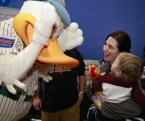 Quacker Jack from the LI Ducks plays peek-a-boo with 10-month old Benjamin Tarasuk and his mom Debbie.